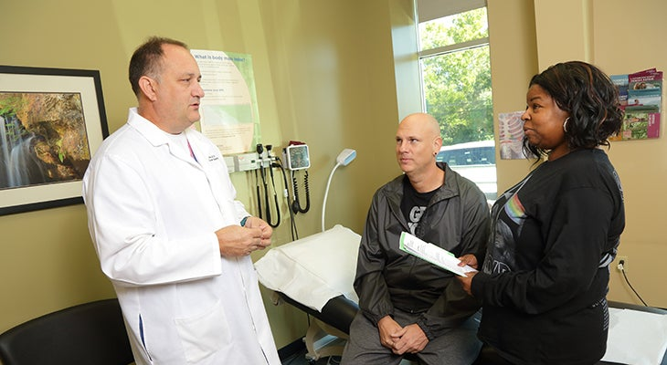 Jeff W. Allen, M.D., discusses weight-loss surgery requirements with a patient.